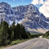 Highway along a beautiful mountain range HD wallpaper