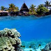 Underwater shot of coral reef and beach hut HD wallpaper
