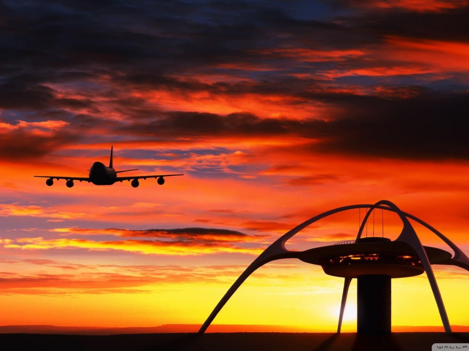 Airplane Landing In Front Of A Sunset Wallpaper