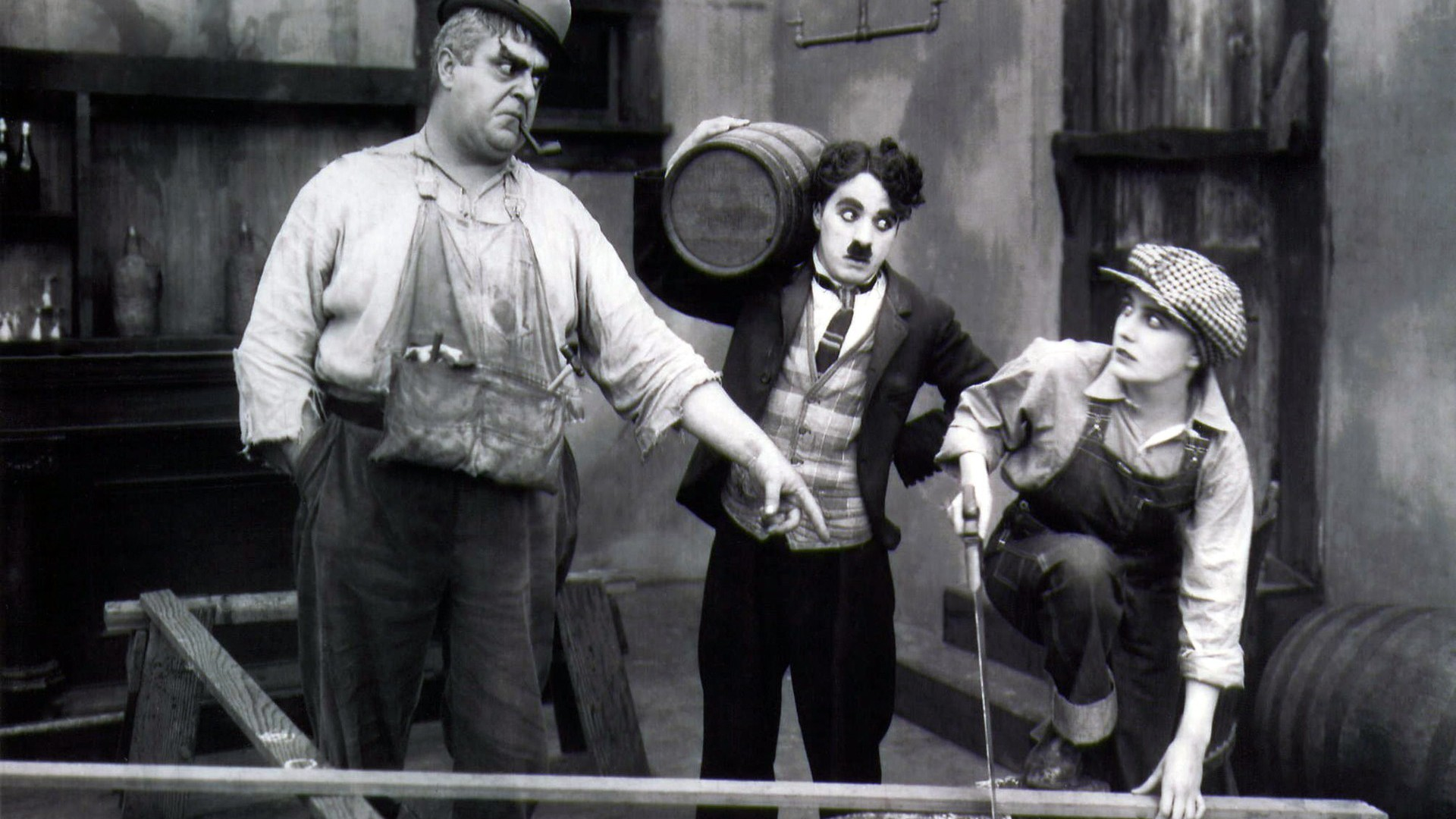 A review of behind the screen a film by charlie chaplin