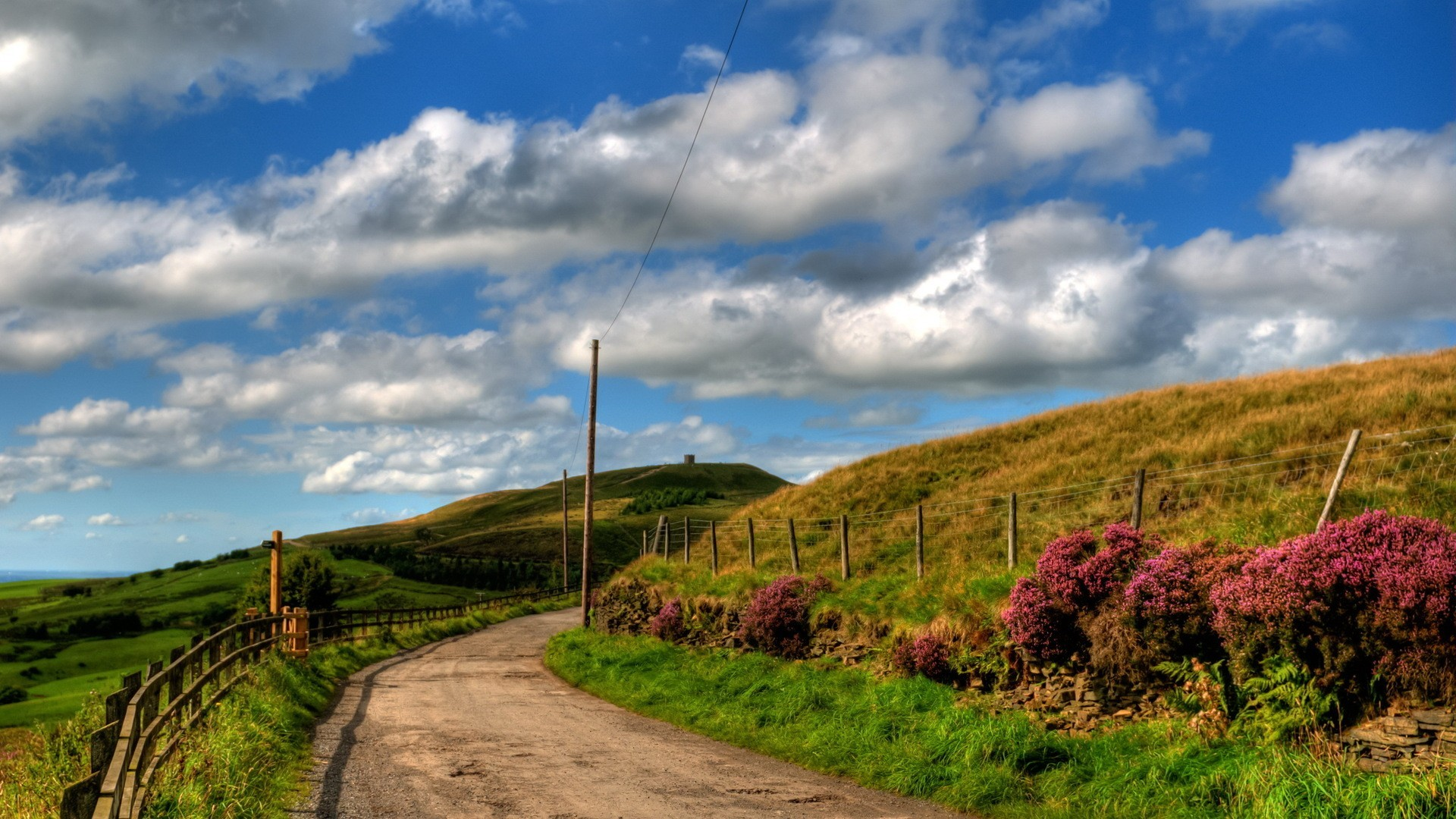 country road on a beautiful spring day wallpaper