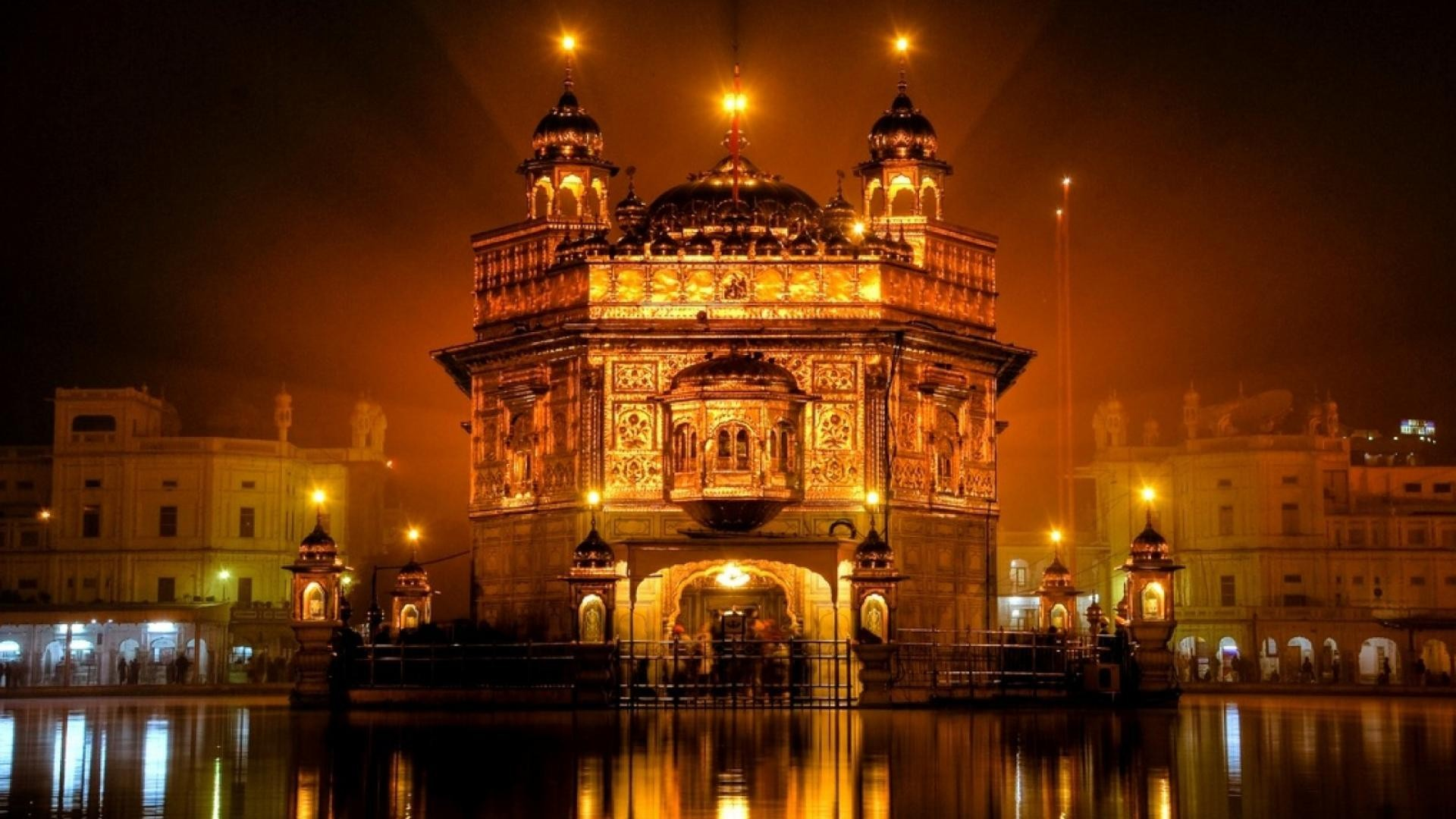 the golden temple at night in amritsar india wallpaper