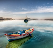 Boat tied up in a peaceful harbor HD wallpaper