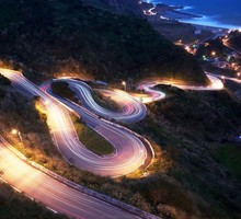 Road in lights down to the beach HD wallpaper