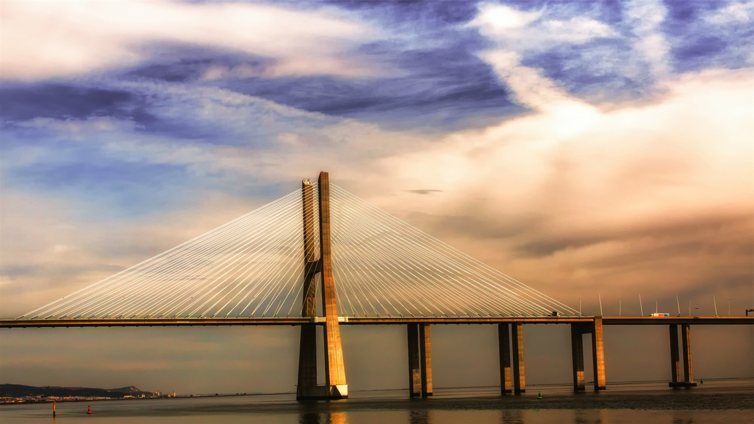 Modern Bridge On The River Tagus In Lisbon Wallpaper