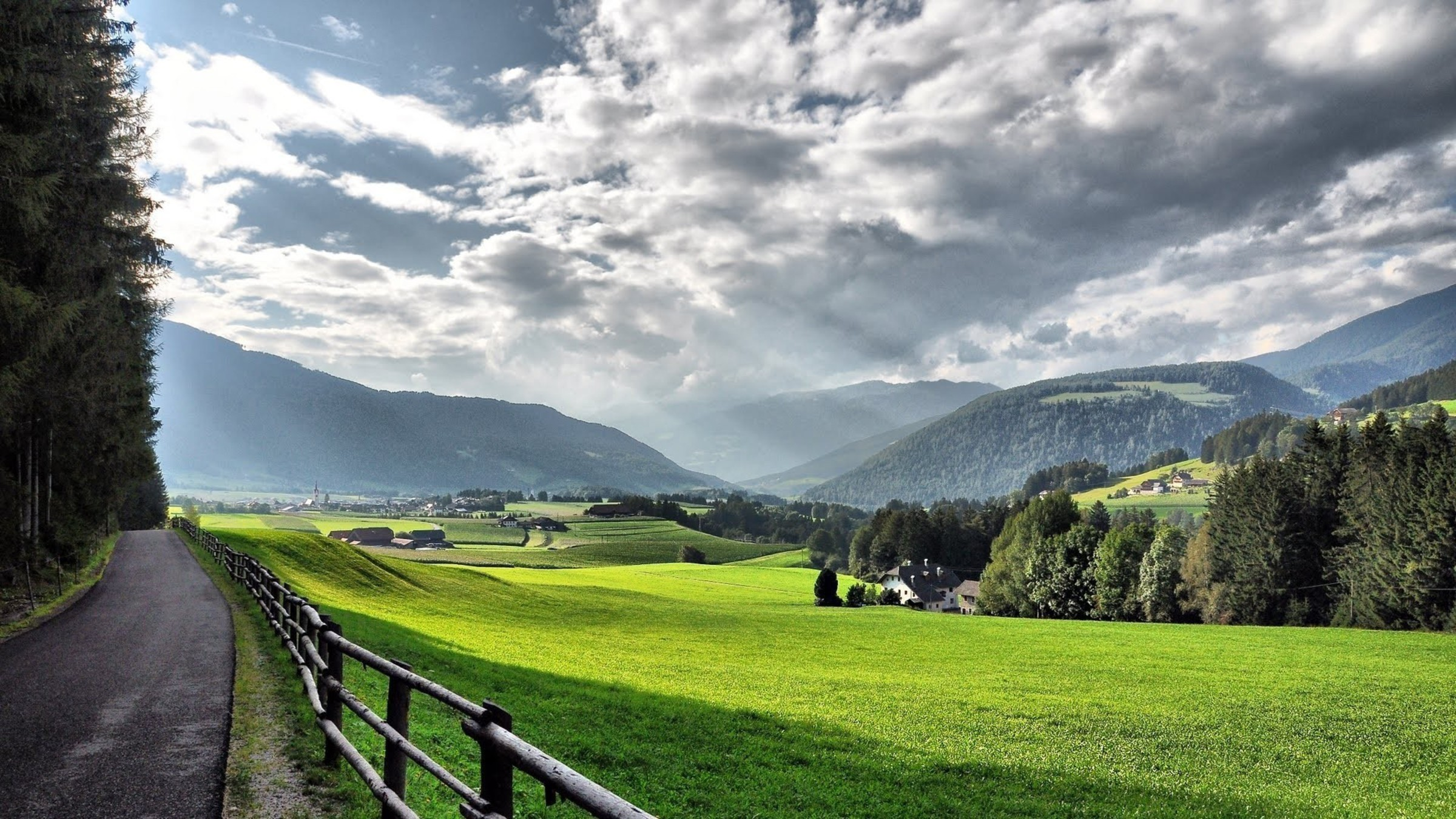 Thru A Beautiful Alpine Valley In Summer Wallpaper