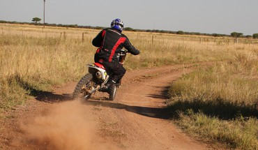 Dust africa motorcycles drifting off-road HD wallpaper