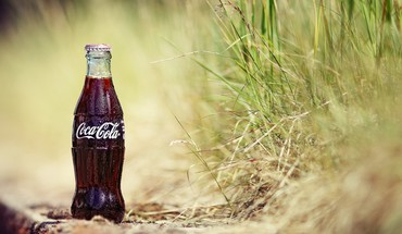 Cocacola bottles grass HD wallpaper