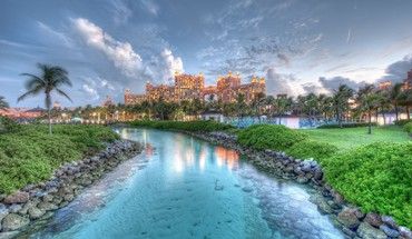 Water clouds grass rocks buildings bahamas sky HD wallpaper