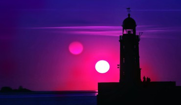 Purple sunset over a lighthouse HD wallpaper