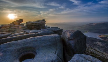 Sunrise over mountain rocks with pools of water HD wallpaper