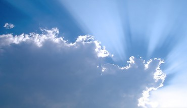The sun is peacking out of clouds HD wallpaper