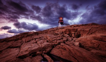 Fantastic lighthouse on a rocky cliff hdr HD wallpaper