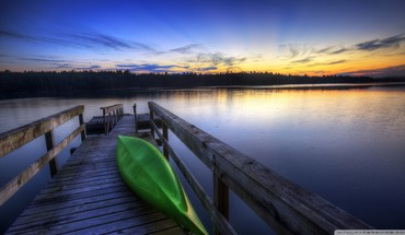 Canoe on dock in evening lake HD wallpaper
