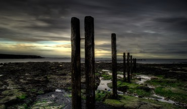 Pylons on a rocky shore twilight hdr HD wallpaper