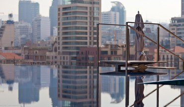 Infinity pool on a city roof HD wallpaper