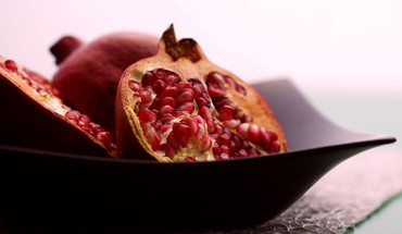Black fruits food pomegranate plates HD wallpaper