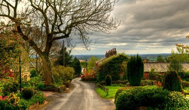 Lovely road through quaint english village HD wallpaper