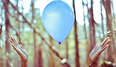 Trees floating hands bokeh balloons HD wallpaper
