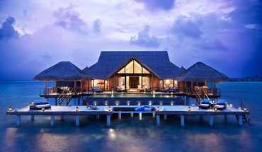 Magnificent resort bungalow on stilts HD wallpaper