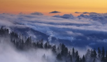 Clouds over forests at sunset HD wallpaper