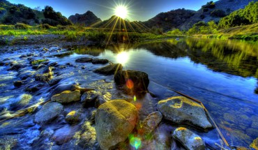 Lovely river cascading over stones hdr HD wallpaper