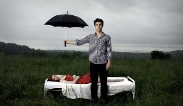 Men couple red dress lying down umbrellas HD wallpaper