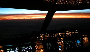 Airbus aircraft cockpit illuminated sunset HD wallpaper