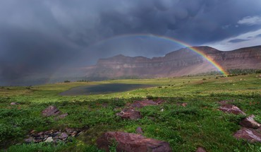 Rainbow over mountain valley HD wallpaper