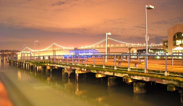 Oakland bay bridge from a pier in frisco HD wallpaper