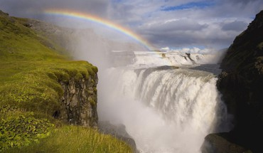 Rainbow over a powerful waterfalls HD wallpaper