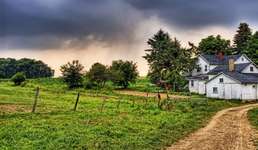 Country home under stormy sky HD wallpaper
