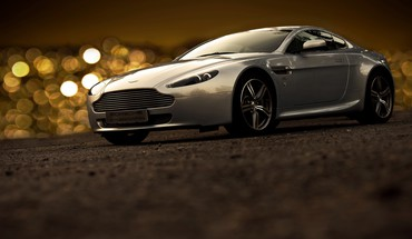 Aston martin bokeh cars vehicles HD wallpaper