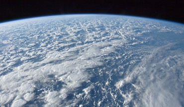 Ocean clouds outer space earth HD wallpaper