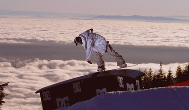 Snowboarding above the clouds HD wallpaper