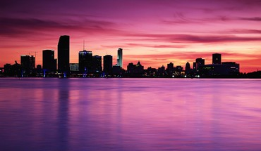 Cityscape between colorful sea and sky HD wallpaper
