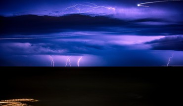 Lightning over a black sea HD wallpaper