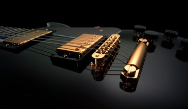Black and gold guitars music HD wallpaper