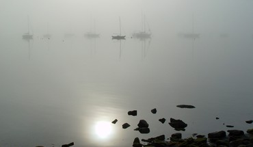 Water rocks fog boats reflections HD wallpaper