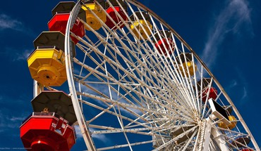 Blue ferris wheels red skyscapes yellow HD wallpaper