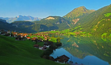 Fantastic village on an alpine lake HD wallpaper