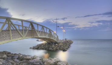 Arched metal bridge to a stone pier HD wallpaper