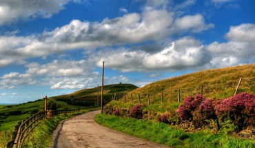 Country road on a beautiful spring day HD wallpaper