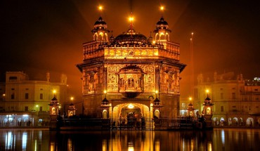 The golden temple at night in amritsar india HD wallpaper