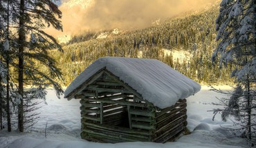 Log cabin in the mountains at winter HD wallpaper
