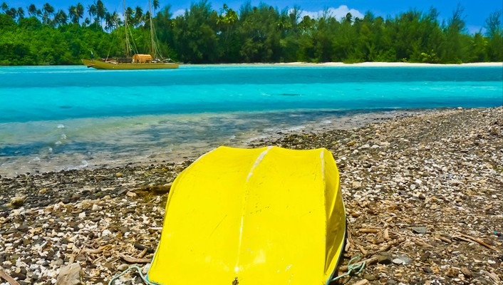 Yellow boat in rarotonga south pacific wallpaper