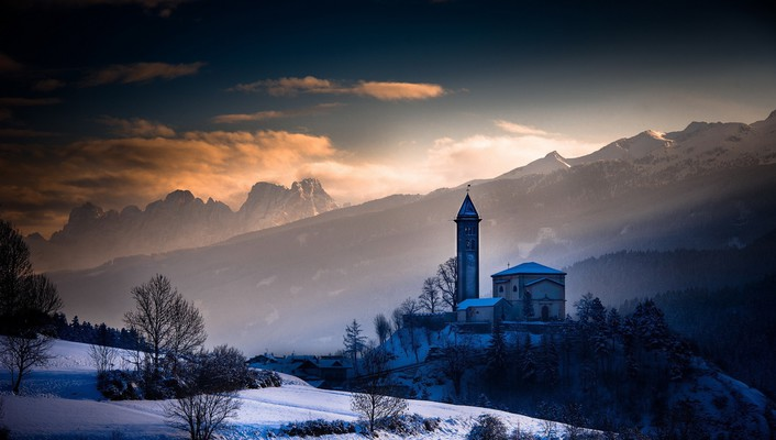 Church above a village in the mountains wallpaper