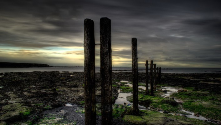 Pylons on a rocky shore twilight hdr wallpaper