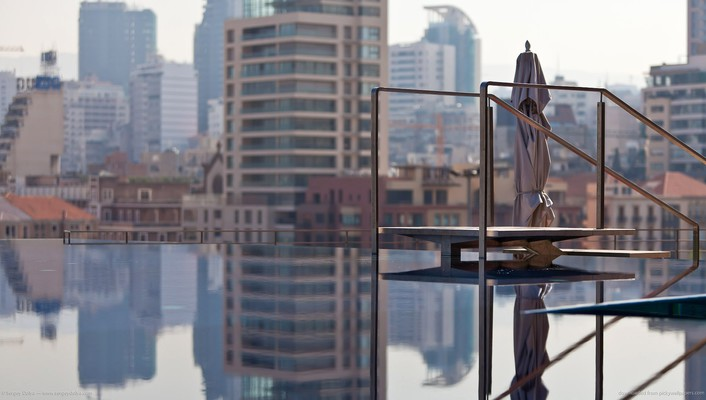Infinity pool on a city roof wallpaper
