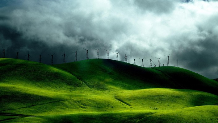 Windmills on grassy hills wallpaper